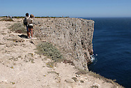 Tourists sightseeing at Cape St Vincent, near Sagres, Algarve. The cape of Saint Vincent (Cabo de S Vicente) is one of the mandatory spots for tourists west from Lagos.