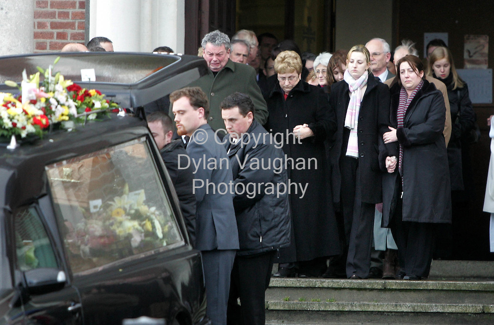 14/12/2005.Family and friends of Fintan Lawler pictured at his funeral at the church in Athy County Kildare yesterday..Fintan was killed on sunday in a car crash which also killed two brothers..