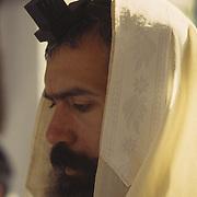 Chassidic man praying in Kosov Synagogue, Tsfat (Safed), Israel.