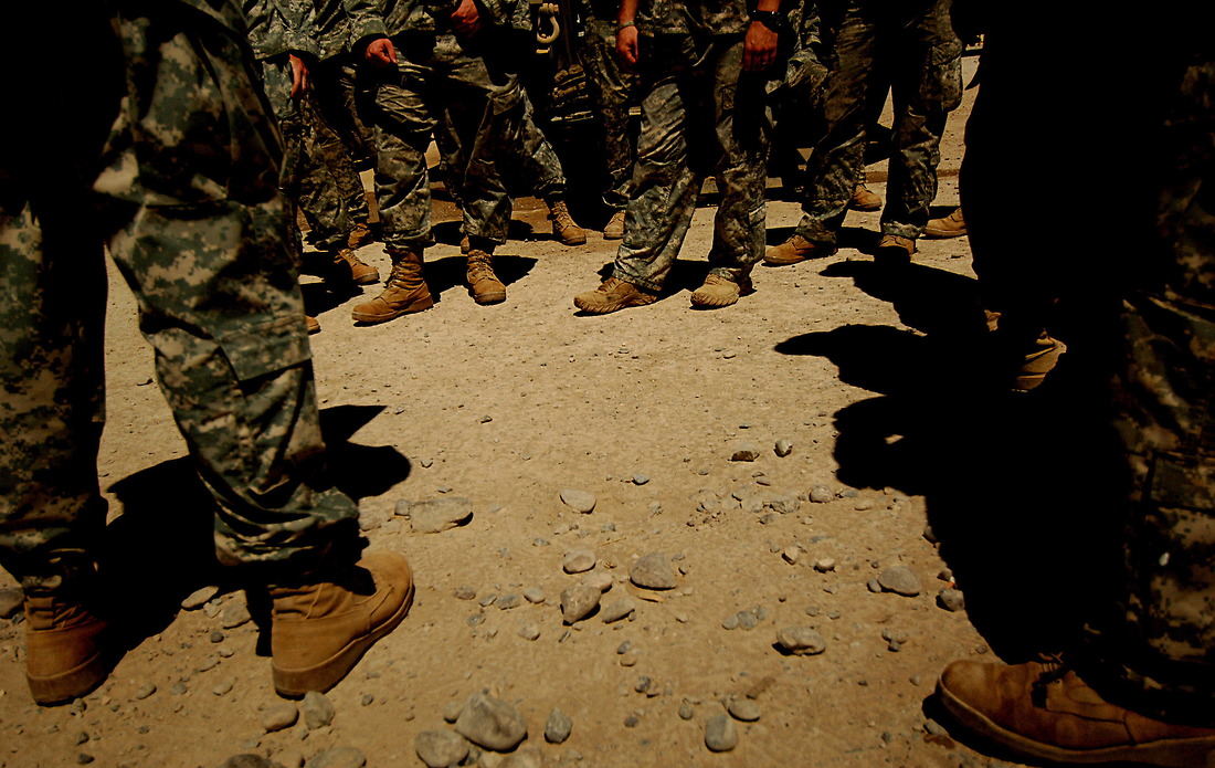Company Commander CPT Kevin Sharp from Bravo Company 1/17th Infantry 172nd Styker BDE Ft. Wainwright, Alaska, briefs his soldiers May 25, 2006 before heading out on patrol in Al Tanak, Mosul, Iraq. — © TSgt Jeremy Lock/