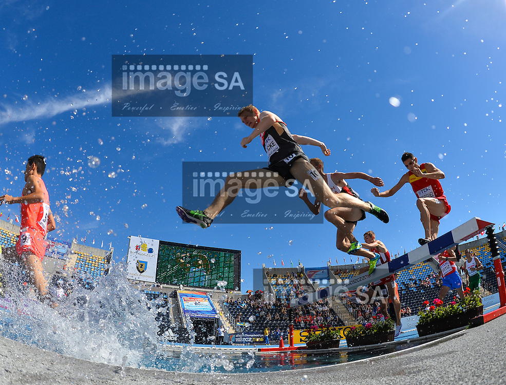 BYDGOSZCZ, POLAND - JULY 21: Lennard Mesecke of Germany at the water jump in the mens 3000m steeplechase during day 3 of the IAAF World Junior Championships at Zawisza Stadium on July 21, 2016 in Bydgoszcz, Poland. (Photo by Roger Sedres/Gallo Images)