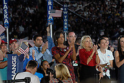 DENVER, CO - August 28, 2008:  Michelle Obama and Jill Biden clap during Barack Obama's acceptance speech the final night the 2008 Democratic National Convention at Invesco Field in Denver, Colorado.