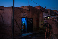 A man inside a store in one of Mopti's alleys. At the confluence of the Niger and the Bani rivers, between Timbuktu and Ségou, Mopti is the second largest city in Mali, and the hub for commerce and tourism in this west-african landlocked country.