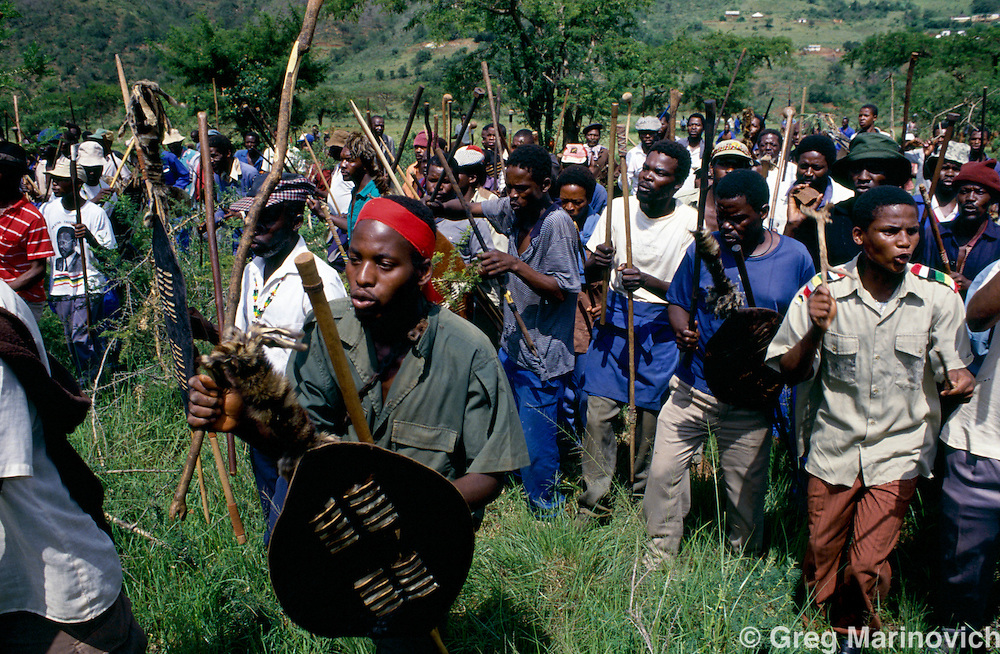 Inkatha Freedom party supporting impi or traditional regiment in rural KwaZulu Natal. 1992-1993.