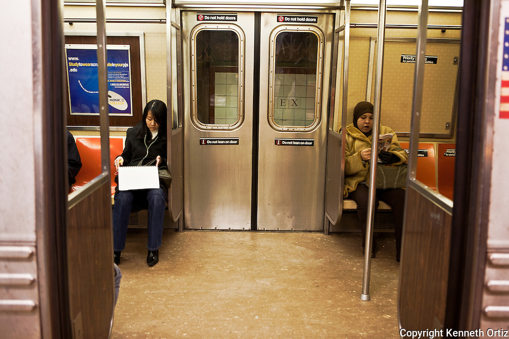 Two women sitting in a train waiting for the doors to close.