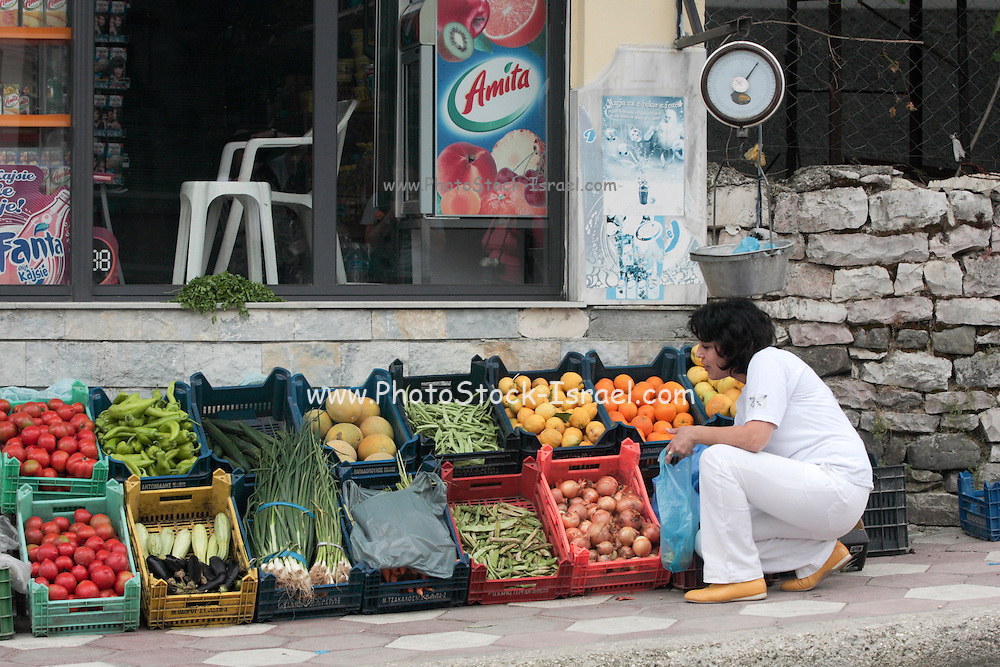 Albania Labova, Woman buying vegetables