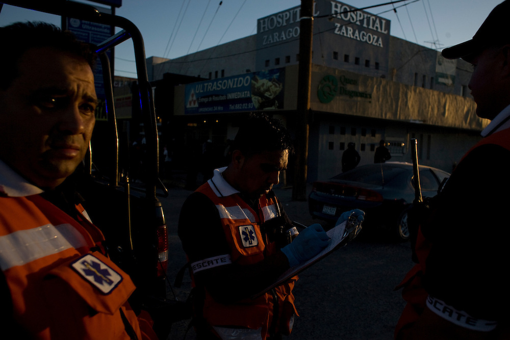 Paramedics respond to a call in Ciudad Juarez, Chihuahua Mexico on May 4, 2010. The death of two 18-year-olds, one of which was pregnant.
