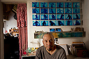 Tijuana Mexico ..photo artist Julio Orozco at his studio..While working on this long term project 'La Frontera' I want to examine the cultural and humanitarian activities on both sides of a border that keeps the United States and Mexico apart with a wall of steel already 600 miles long. The turf wars of drug cartels, arms trafficking and rampant kidnappings turned cities like Tijuana into some of the most dangerous places on earth. Despite the violence many brave artists, photographers, architects, poets, humanitarians, teachers etc live and work in the shadow of the wall on both sides and have a positive influence on this region; they are the focus of my long term project along the border. (Over time I plan to cover the entire length from the Atlantic to the Pacific, these images were taken in and around Tijuana).© Stefan Falke