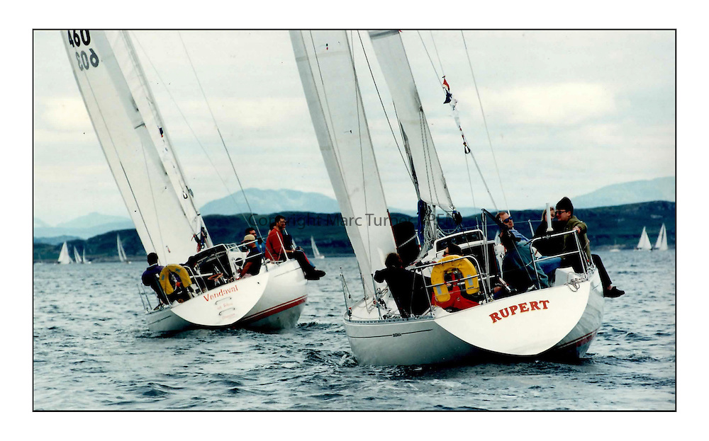 The Clyde Cruising Club's Scottish Series held on Loch Fyne by Tarbert. <br /> <br /> Sigma 33's Vandaval and Rupert Katy Watson 1997<br /> <br /> Picture Copyright  PFM Pictures