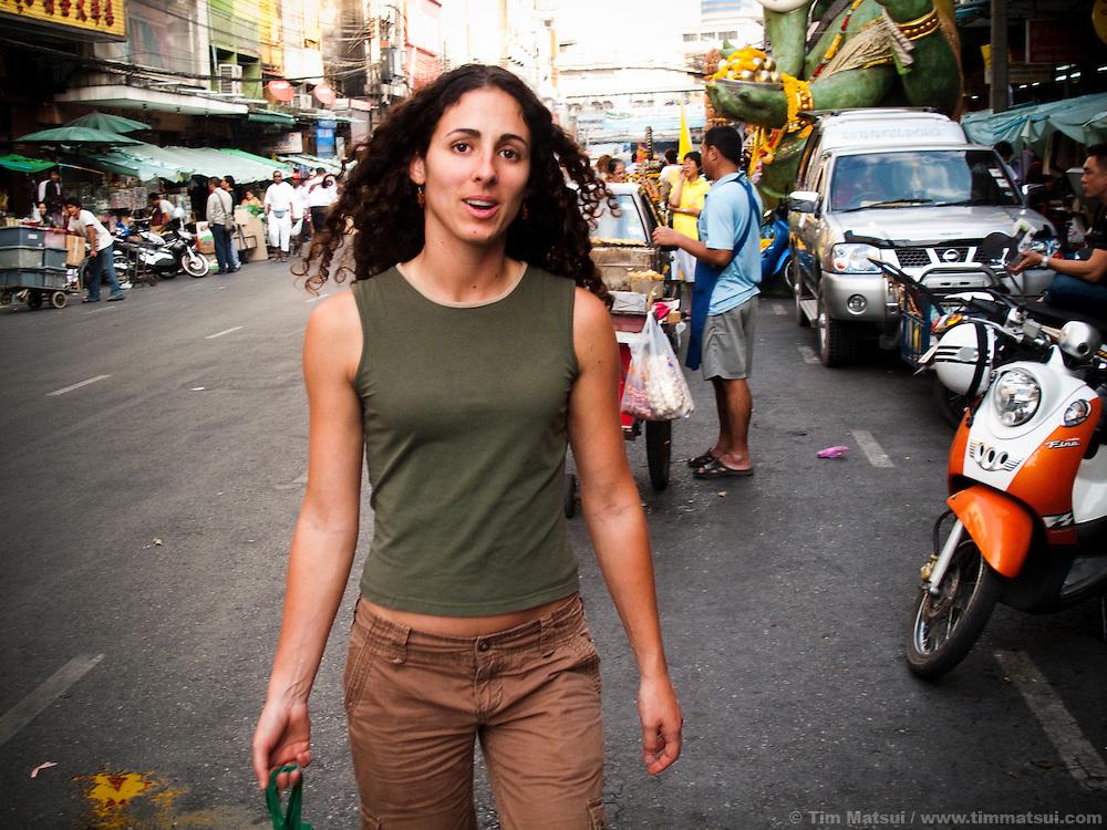 A caucasian woman on the streets of the Phahurat neighborhood, Bangkok, Thailand.