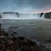 "Goðafoss, which means ""Waterfall of the Gods,"" is regarded as one of the most spectacular waterfalls in Iceland. Located near Mývatn, it plunges 12 meters and is more than 30 meters wide."