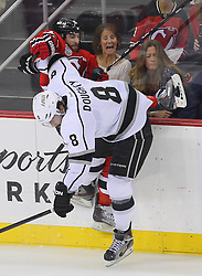 June 2; Newark, NJ, USA; Los Angeles Kings defenseman Drew Doughty (8) hits New Jersey Devils right wing Stephen Gionta (11) during the first period of the 2012 Stanley Cup Finals Game 2 at the Prudential Center.