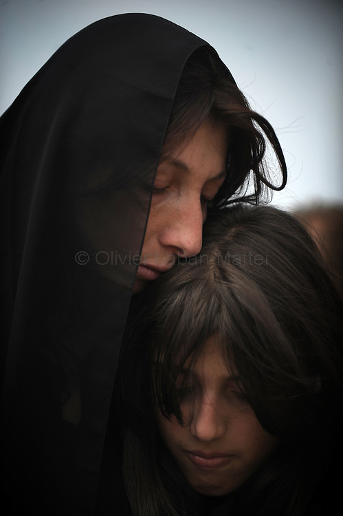 A woman hugs her daughter during the military funerals of her late husband, a Georgian soldier killed in South Ossetia, on August 30, 2008, in Mukhadgverdi, west of Tbilisi. Russian President Dmitry Medvedev called Saturday on European governments to send more observers to Georgia, a Kremlin statement said.