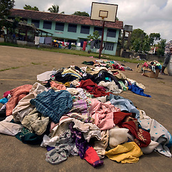 Used clothing lies in piles after members of the small Christian village Dutch Bar picked out the usable items, Batticaloa, Sri Lanka, March 7, 2005. Residents of the village spent more than six weeks in a makeshift refugee camp at the local convent recovering from the devastating tsunami that hit the eastern and southern borders of Sri Lanka. They were then moved into another temporary living camp, while awaiting the building of new homes.