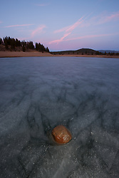 """Rock on Prosser Reservoir Sunset"" - Sunset photograph of a rock sitting on top of an icy frozen Prosser Reservoir in Truckee, CA."