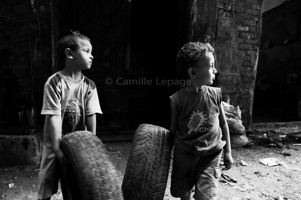 In the outskirts of Cairo, hidden behind the Historical Egyptian Citadel, is located 'Garbage City'. The City is organized around the recycling of rubbish they collect around Cairo. Incredible amount of garbage submerge the streets, children play among them while adults try to make a living out of it.