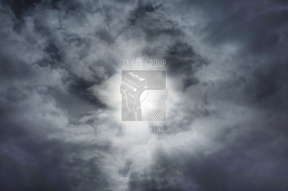 Sunburst in clouds with faint Christ figure emanating from center