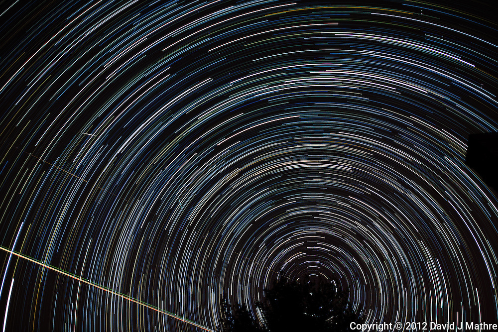 Winter Night Sky -- Star Trails -- Quadrantids Meteors. Composite of 122 images taken with a Nikon D3x and 24 mm f/1.4 lens (ISO 100, 24 mm, f/2, 59 sec) combined using the Startrails program. .