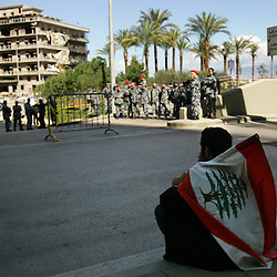 A demonstrator is seen at the site of the bombing that killed former Prime Minister Rafik Hariri, Beirut, Lebanon, Feb. 21, 2005. Several thousand Lebanese gathered at the scene and then walked to Hariri's grave. The crowd demanded a Syrian pullout and an international probe into the assassination.