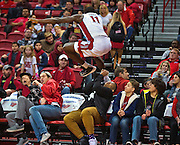 UNLV forward Cheickna Dembele (11) leaps into the stands chasing a loose ball and does his best to avoid the fans during their game at the Thomas & Mack Center on Saturday, Nov. 19, 2016.  L.E. Baskow