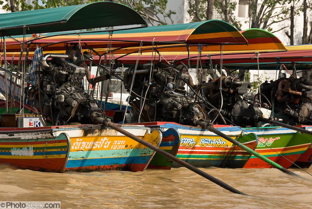 Long propeller shafts of long tail boats in a khlong (canal), Bangkok, Thailand