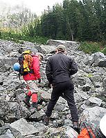 Tim McGuire photographing Cebe Wallace below Guye Peak near Snoqualmie Pass, Washington Cascades, 2004.