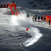 (SANTA CATERINA, Italy - Shot 2/2/2005).U.S. women's downhiller and Vail, CO native Lindsey Vonn (#16) kicks up snow as she carves through a set of gates during training on Wednesday on the Pista Deborah Compagnoni slope. The second of three training runs was held Wednesday in Santa Caterina on the Pista Deborah Compagnoni slope in Santa Caterina, Italy in preparation for Sunday's women's downhill at the FIS Alpine World Ski Championships..
