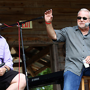 Jim Wallis, right, participates in a discussion with festival director Gareth Higgins, left, and T Bone Burnett (not in photo) at the Wild Goose Festival at Shakori Hills in North Carolina June 23, 2011.  (Photo by Courtney Perry)