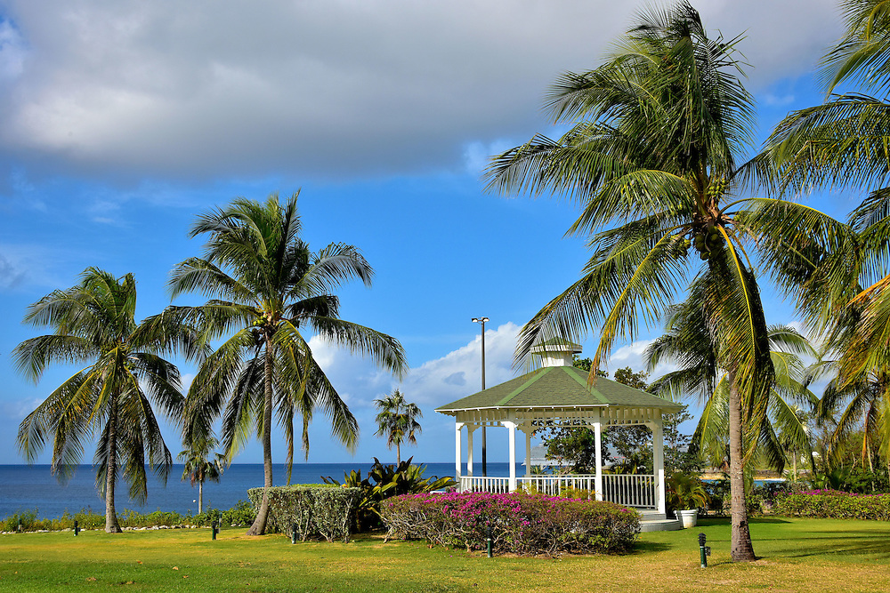 Gazebo at Pedro St. James Castle in Savannah, Grand Cayman <br /> This gazebo overlooking the southern shore is on the meticulous grounds of Pedro St. James Castle, a National Historic Site. Grand Cayman&rsquo;s oldest building stands near this waterfront on Pedro Point. The person who gave me access to photograph this living history museum in Savannah was Debbie Bodden. She shares the surname of the island&rsquo;s first settler.  Also spelled Bawden or Bowden, he was an English soldier with Oliver Cromwell&rsquo;s army during the British attack of Jamaica in 1655.  His grandson, Isaac Bodden, was born in 1661 and became the island&rsquo;s first native resident.