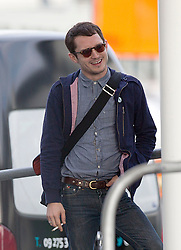 Hobbit actor, Elijah Wood has time for a smoke between flights after arriving  on a flight form Los Angeles, Auckland, New Zealand, Sunday, November 25, 2012. Credit: SNPA /  Simon Runting