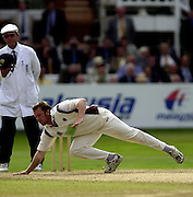 Photo Peter Spurrier.31/08/2002.Cheltenham & Gloucester Trophy Final - Lords.Somerset C.C vs YorkshireC.C..Somerset's Keith Dutch diving for a straight drive from Michael Vaughan.