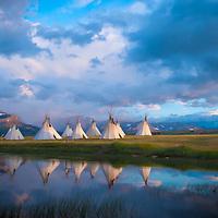 indian tepee village camp on lake near glacier park, blackfeet reservation