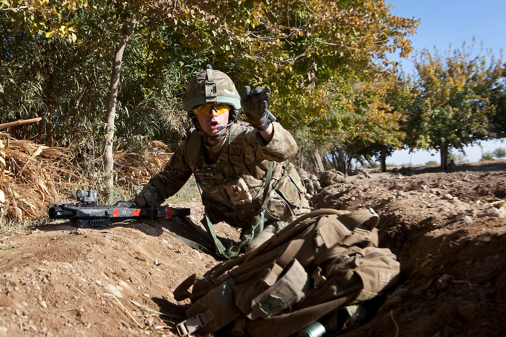 British soldiers from 1PWRR (Princess of Wales's Royal Regiment) are involved in an ongoing series of Operations called Tora Pishaw aimed at disrupting insurgent activity in their AO (Area of Operations). During the most recent 4 day operation the soldiers regularly came under fire from insurgents using small arms, belt fed machine guns and UGL's (Under Slung Grenade Launchers). The soldiers returned fire using shallow trenches on the edges of ploughed fields or irrigation ditches as cover. Nad I Ali North, Helmand Province, Afghanistan on the 13th of November 2011.
