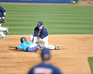 Ole Miss' Austin Anderson (8) tags out  North Carolina-Wilmington's Michael Bass (6) at Oxford-University Stadium in Oxford, Miss. on Friday, February 24, 2012. Ole Miss won 2-0.