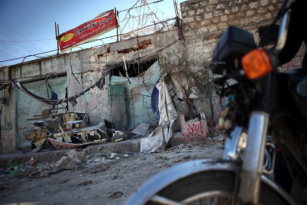 A motorcycle pass a house demolished by shelling in Idlib, Province of Idlib, Syria.