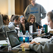 03/21/2014- Plover, Wisc. - The Tufts women's basketball team watches a rough cut of a documentary shot by Michela North, A17, for the NCAA Division III Women's Final Four at the team hotel on Mar. 21, 2014. (Kelvin Ma/Tufts University)