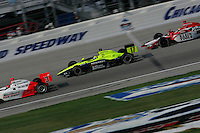 Helio Castroneves, Vitor Meira and Dan Wheldon race at the Chicagoland Speedway, September 11, 2005