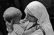 Mother Teresa, the Catholic nun who was leader of the Missionaries of Charity order, held a small child in her arms following a mass in Jenkins, KY, June 19, 1982.  She came to the Appalachian community in southeast Kentucky to preside over the opening of first branch of the order in a rural American community.  She also was honored for her lifelong work in a ceremony  at Bellarmine College in Louisville, KY several days later.  Pope John Paul II, during the celebration of his 25 years as leader of the world's Catholic religion, will likely beatify Mother Teresa.