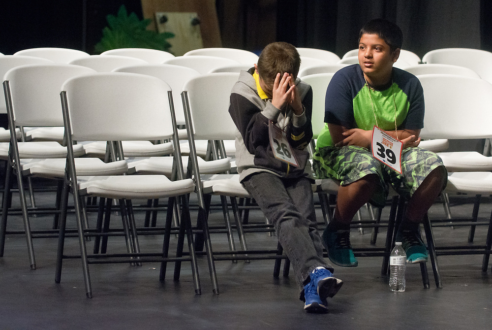 Diego Luna, left, a 6th grader from Valencia County, and Adeeb Khan, right, a 7th grader from Albuquerque Academy, wait for their turns to compete in one of the last rounds of the 2017 New Mexico Spelling Bee at Sandia Prep, Saturday, March 18, 2017. (Marla Brose/Albuquerque Journal)