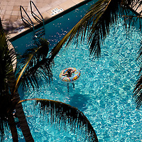 NAPLES, FL -- March 13, 2010 -- Children play in the pool at The Ritz-Carlton in Naples, Fla., on Saturday, March 13, 2010.  There is a push to make hotels more family and kid-friendly.  The three hour Nature's Wonders program let kids experience a more involved, educational nature program while parents get free time to enjoy themselves sans kids.