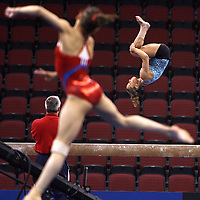 Alicia Sacramone, background,  of Winchester prepares for the VISA Championships on the balance beam during a workout at BU's Agganis Arena, Wednesday,  June 04, 2008.