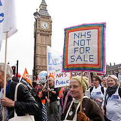 London, UK - 20 October 2012: a woman holds a sign reading 'NHS not for sale' during the TUC-organised march 'A future that works' against austerity cuts in central London.