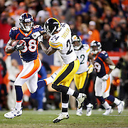 SHOT 1/8/12 7:09:07 PM - The Denver Broncos Demaryius Thomas #88 stiff arms the Pittsburgh Steelers Ike Taylor #24 on his way to scoring the game winning touchdown in overtime during their AFC Wildcard game at Sports Authority Field at Mile High on Sunday January 8, 2012. The Broncos won the game in overtime 29-23. (Photo by Marc Piscotty / © 2012)