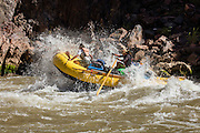 Rafters making the run through Specter Rapids (river mile 130) on the Colorado River. Grand Canyon National Park in Arizona.