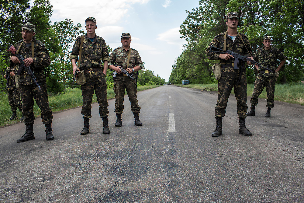 VOLNOVAKHA, UKRAINE - MAY 22:  Ukrainian soldiers guard a checkpoint which was attacked earlier in the day by unknown forces on May 22, 2014 in Volnovakha, Ukraine. Authorities reported fifteen soldiers were killed and 31 injured. (Photo by Brendan Hoffman/Getty Images) *** Local Caption ***