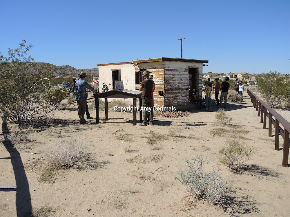 "High Desert Test Sites 2013, Eames Demetrios, ""Kcymaerxthaere Story Telling"" visitors exploring Krblin Jihn Cabin in Joshua Tree."