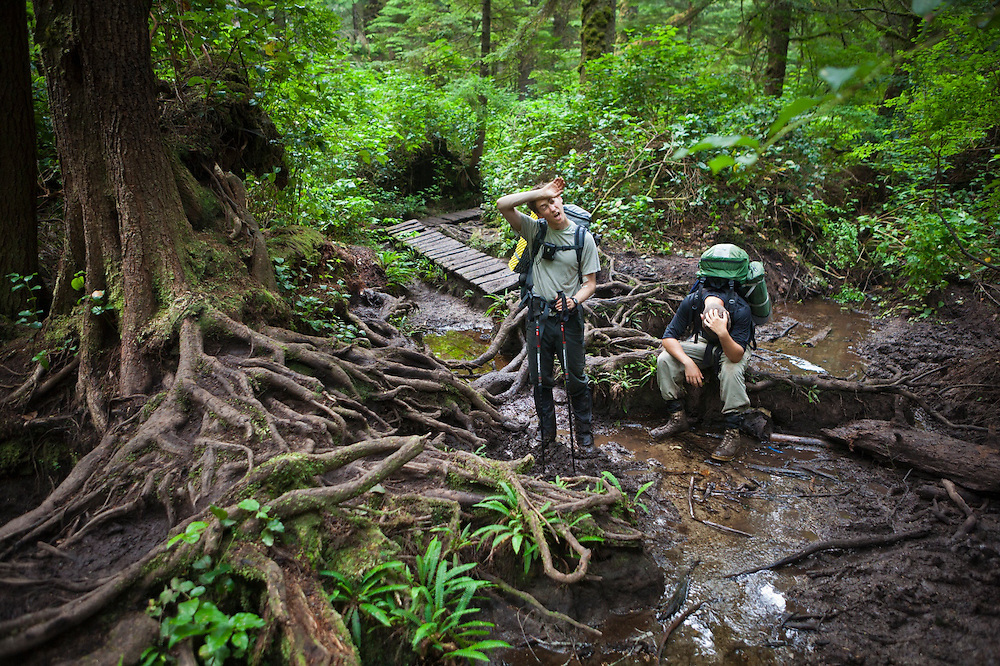 Zach Podell-Eberhard (left) and Henry Pedersen show their exhaustion tackling a particularly difficult, muddy portion of the West Coast Trail, British Columbia, Canada.
