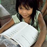Shipibo Indian girl at school in village on shores of Ucayali River, Peru. Shipibo language belongs to the Panoan family.