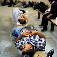 Undocumented migrants wait in a federal holding cell in Yuma, Arizona to be deported after being picked up in the desert.