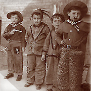 Vintage Image.kids as cowboys & Indians, dated 1911.play, boys, kids, guns, toys.
